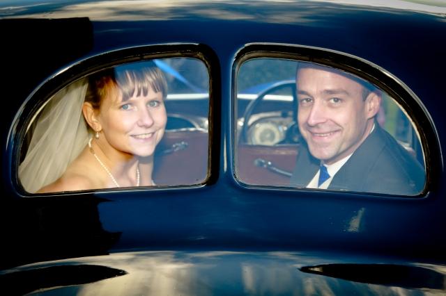 Karl and Sarah Austin following their wedding at St Hubert's at Harrowden Hall